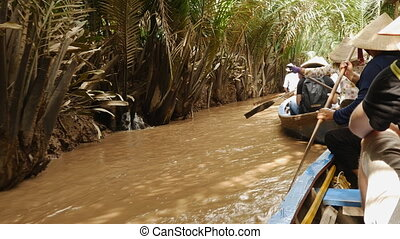 Tourists ride on a boat on the Mekong River Delta. -...