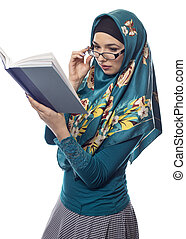 Female Student in Hijab Reading a Book - Female foreign...
