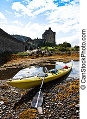 Kayak and castle - Kayak in front of Eilean Donan Castle,...