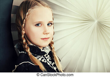 Beautiful girl with fashion hairstyle