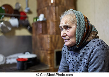 Senior farmer woman indoor in her house