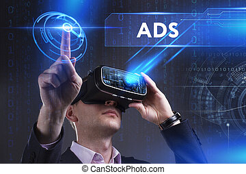Business, Technology, Internet and network concept. Young businessman working in virtual reality glasses sees the inscription: ADS