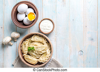 vareniki with sour cream, space for text left, topshot -...