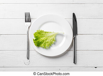 White plate with lettuce, vegeterian, topview - White round...