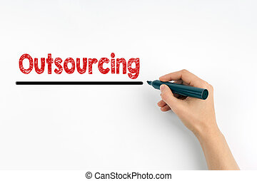 Hand with marker writing - Outsourcing concept. White paper...