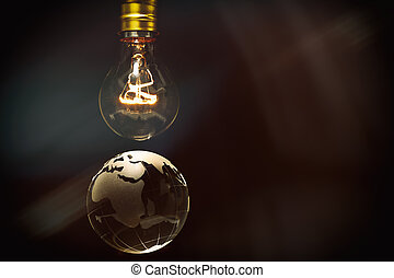 Light bulb and earth, concept of global issues, Europe,...