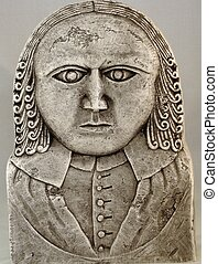 Carving of a Stern Pilgrim - Stone carving of an American...
