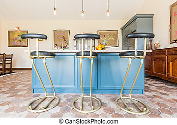 Kitchen with a table top and bar stools - View of the...
