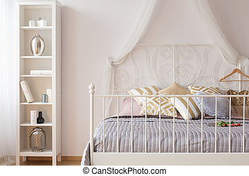 Canopy bed with metal headboard - Interior with canopy bed...