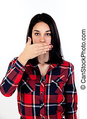 Brunette young woman covering her mouth isolated on a white...