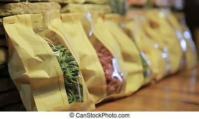 Diferent types of pasta in packages. Close up of italian...