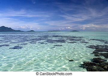 Coral Reef and Islands - Image of a coral sea with islands...