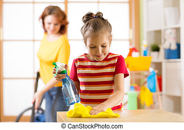child girl and her mother make cleaning in room at home