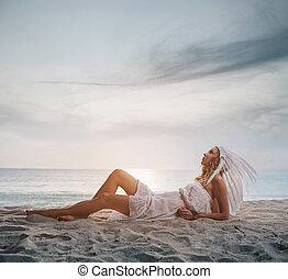 Blond lady wearing a white plume - Blond lady wearing a...