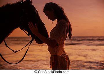 Calm woman cuddling a majestic stallion - Calm sensual woman...