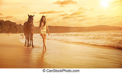 Charming brunette walkig with her loyal horse companion