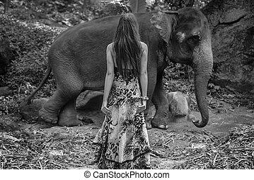 Black&white portrait of an alluring elephant tamer -...