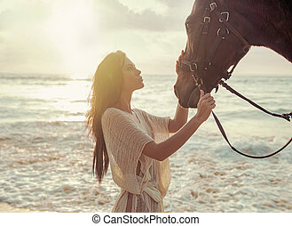 Charming lady stroking her beloved horse friend - Charming...