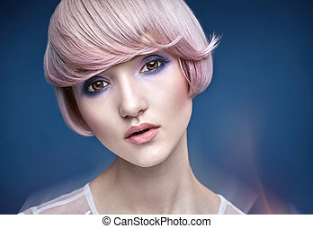 Closeup portrait of a girl with a pink haircut