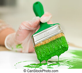 arty fun times - Paintbrush with green paint dripping on to...
