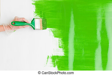 arty fun times - woman hand holding paint brush and painting...