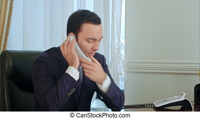 Businessman discussing document with colleague on mobile...