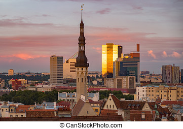 Townhall and modern buildings against sunset sky, Tallinn