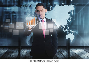 Attractive asian businessman touching digital chart with finger