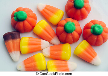 Halloween Candy Corn - A pile of Halloween candy corn on a...