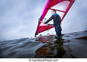 windsurfer waiting for the wind - professional windsurfer...