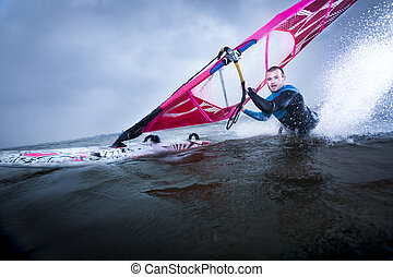 body drag stunt by a professional freestyle windsurfer -...