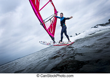 tricks on a windsurf board - freestyle windsurfer doing...