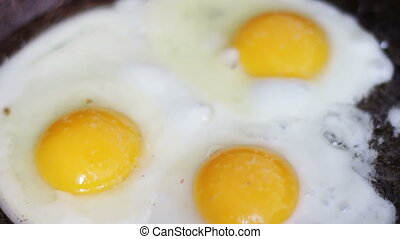 Cooking eggs in a frying pan.Top view.