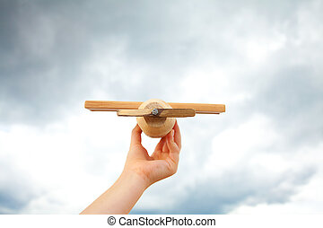 Airplane toy in the cloudy sky