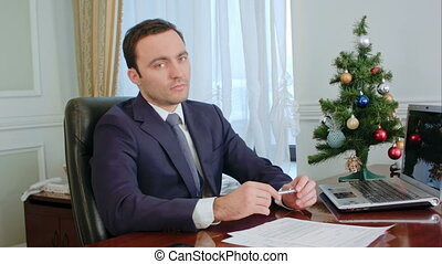 Portrait of a serious young handsome businessman looking in camera, serious thoughtful