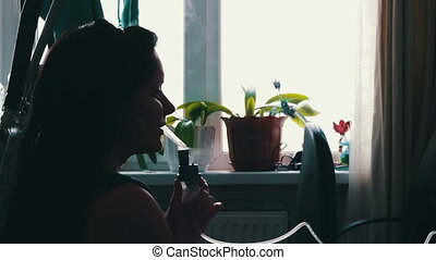 The girl with the disease asthma, using a nebuliser at home...