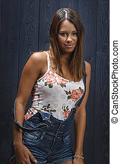 shy girl in overall - twenty something beautiful girl with...