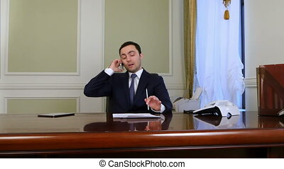 Businessman discussing contract on the phone. Professional...