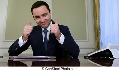 Smiling businessman with thumb up and showing okey....