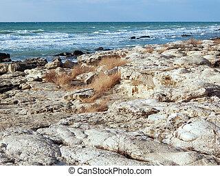 Caspian Sea. - Rocky shore of the Caspian Sea. Month...