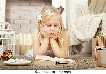 Child girl reading a book