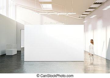 Woman walking near blank white wall mockup in modern...