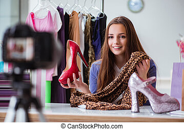 Fashion blogger recording video for blog
