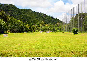 Driving range on the golf course and mountain