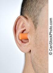 man with an earplug in his ear