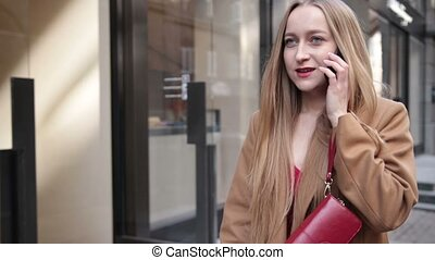 Confident business woman talking on mobile phone