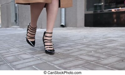 Close up of elegant female legs walking in street - Closeup...