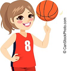 Girl Spinning Basketball - Active teenager girl spinning...