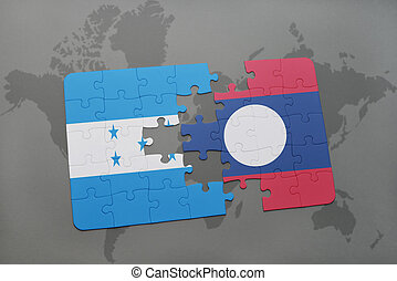 puzzle with the national flag of honduras and laos on a...