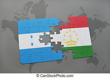 puzzle with the national flag of honduras and tajikistan on...